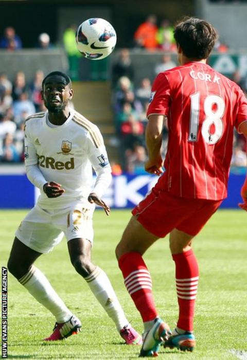 Swansea City's Nathan Dyer, a former Southampton player, attempts to head the ball past Jack Cork during the Premier League game at the Liberty Stadium.