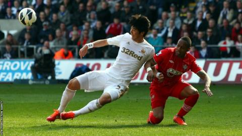 Swansea midfielder Ki Sung-Yueng battles for the ball with Southampton's Nathaniel Clyne during the goalless draw at the Liberty Stadium.