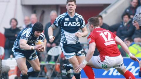 Blues full-back Leigh Halfpenny takes on Scarlets centre Scott Williams