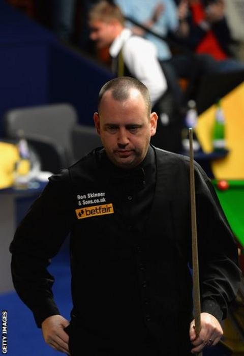 Mark Williams walks off at the Crucible following his first round defeat to fellow Welshman Michael White in the World Championship.