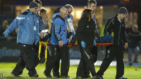 Glasgow's Duncan Weir leaves the field on a stretcher