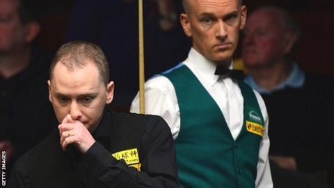 Graeme Dott (left) eyes up a shot as Peter Ebdon looks on from behind
