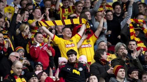 Partick Thistle fans celebrate winning the First Division title