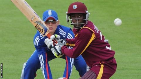 West Indies' Shemaine Campbelle hits out, watched by England keeper Sarah Taylor