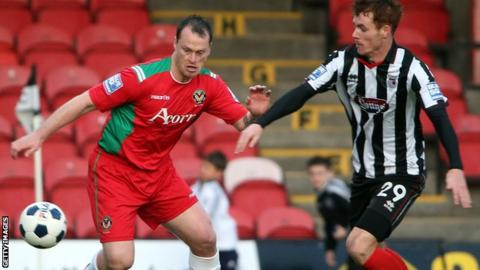Newport's Mike Flynn in action against Grimsby's Tom Naylor