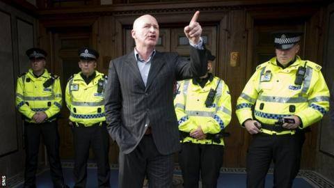 John Brown addresses Rangers fans at the main door at Ibrox last July