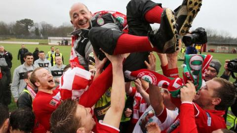 Tommy Breslin celebrates the title triumph with his Cliftonville team