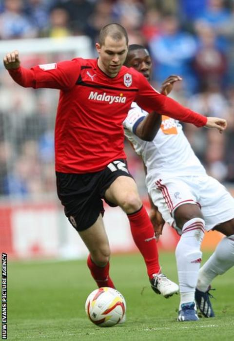 Cardiff defender Matthew Connolly holds off Bolton striker Marvin Sordell in the Championship clash at Cardiff City Stadium.
