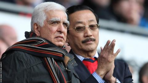 Former Cardiff City chairman Sam Hammam (left) watches the Championship match against Bolton as a guest of current owner Vincent Tan