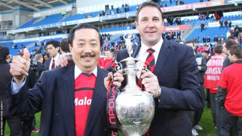 Cardiff City owner Vincent Tan and manager Malky Mackay proudly show off the Championship trophy