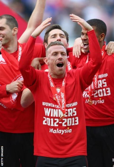 Wales striker Craig Bellamy leads Cardiff's celebrations