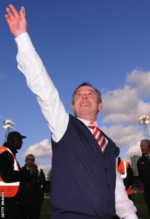 Former Wales caretaker manager Brian Flynn salutes the Doncaster Rovers following a 1-0 win at Brentford which secured promotion to the Championship