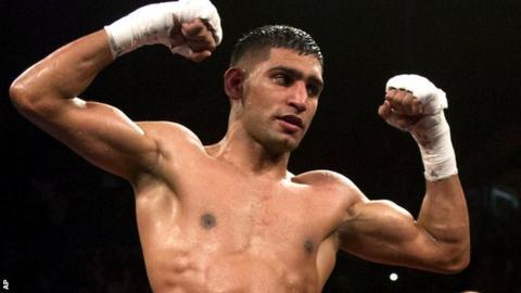 Amir Khan celebrates