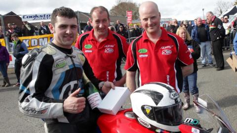 Michael Dunlop celebrates his two Cookstown 100 Superbike wins with members of his team