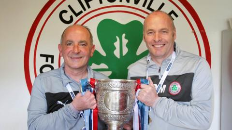 Cliftonville manager Tommy Breslin and assistant Peter Murray pictured with the Gibson Cup