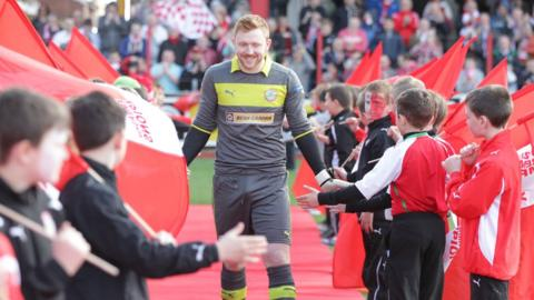 Cliftonville goalkeeper Conor Devlin prepares to collect his Premiership medal