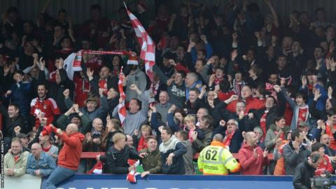 Wrexham fans, with over 1,500 in attendance at Aggborough, celebrate Brett Ormerod's goal.