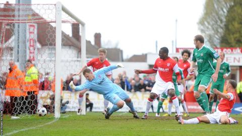 Although Chey Dunkley scores for Harriers, Joe Clarke's free-kick restores Wrexham's advantage at Aggborough.