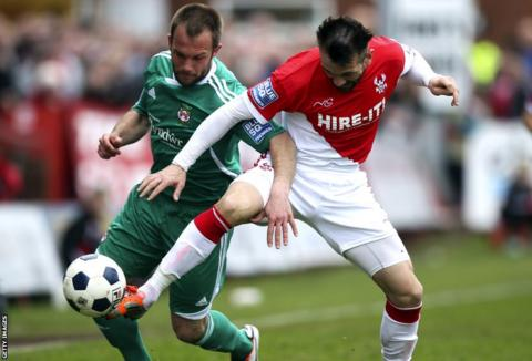 Wrexham left-back Neil Ashton battles for the ball with Kidderminster's Martin Devaney