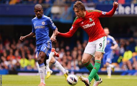 Chelsea's Ramires keeps a close eye on Swansea's Michu.