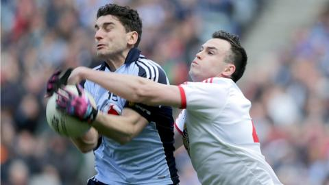 Bernard Brogan and Cathal McCarron vie for possession during a keenly contested Division 1 final