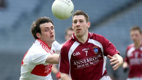 Eoin Bradley and James Dolan battle for possession during Sunday's Division 2 final at Croke Park