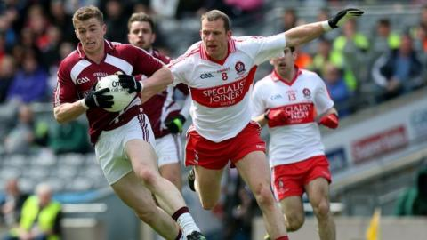 Westmeath's Ger Egan wheels away from Patsy Bradley as Derry secure the Division 2 title in Dublin