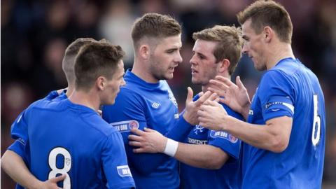 Rangers players celebrate after their fourth goal