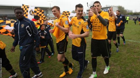 Newport players celebrate the victory over Grimsby following the final whistle at Rodney Parade.