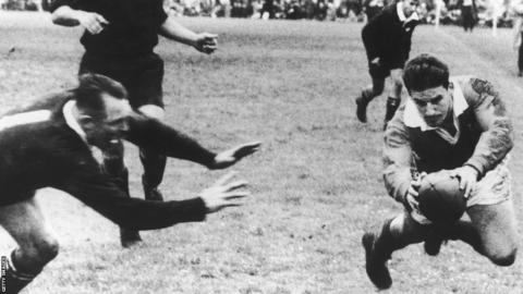 1959: 26th September 1959: British Lions' fly half Bev Risman scores in the rugby final Test match against New Zealand in Auckland. DB Clarke leaves the tackle too late.