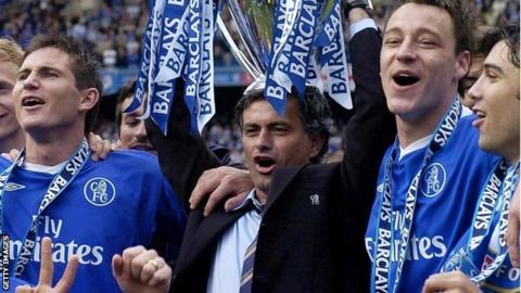 Jose Mourinho lifts the Premier League trophy