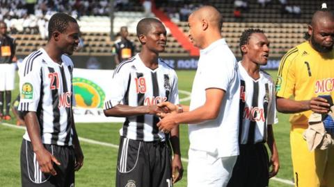 Moise Katumbi greets some of his Ghanaian players