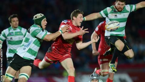 Scarlets fly-half Rhys Priestland under pressure against Treviso