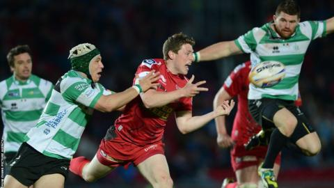Scarlets fly-half Rhys Priestland gets the ball away under pressure from the Treviso defence during Friday's Pro12 meeting at Parc y Scarlets