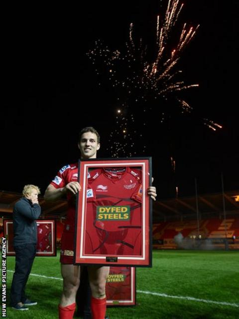 With fireworks lighting the sky, George North is presented with a commemorative jersey after his final home Scarlets appearance before joining Northampton Saints