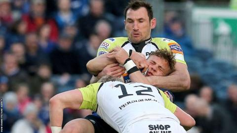 Leinster's Ian Madigan is wrapped up by Ospreys pair Joe Bearman and Ben John