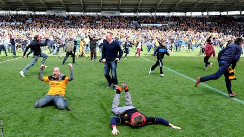 Hull City fans celebrate promotion to the Premier League as runners-up after Watford lose at home to Leeds United