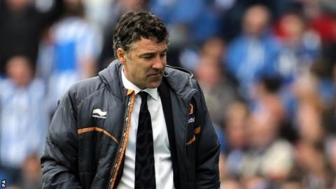 Dejected Wolves boss Dean Saunders