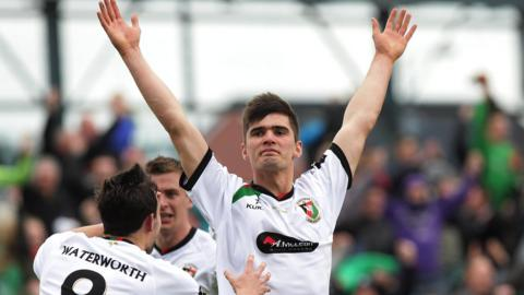 Jimmy Callacher celebrates after his headed goal puts Glentoran 2-1 ahead in the first period of extra-time