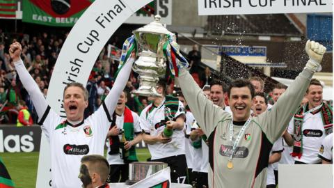 Glentoran captain Colin Nixon, who made his 794th and last appearance for the club, lifts the Irish Cup with goalkeeper Elliott Morris