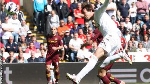Michu on the attack for Swansea against Manchester City