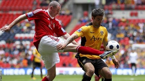 Stephen Wright of Wrexham battles with Andy Sandell of Newport during the Blue Square Bet Premier Conference Play-off Final