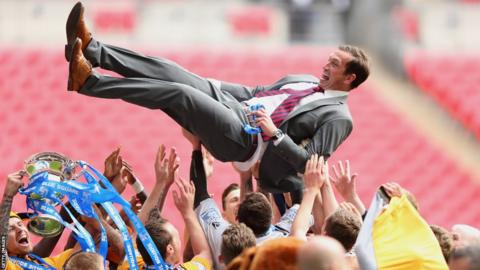 Newport County manager Justin Edinburgh is hoisted aloft by his players after winning the Blue Square Bet Premier Conference Play-off Final against Wrexham
