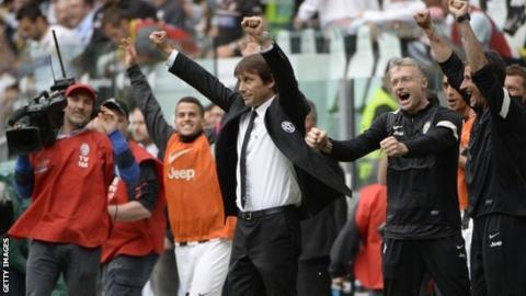 Juventus coach Antonio Conte celebrates his side's title triumph