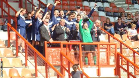Jersey Scottish lift the trophy
