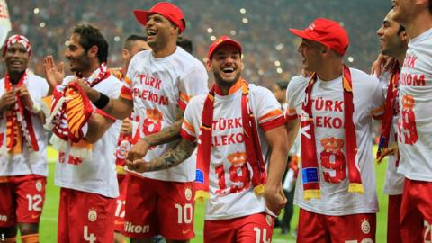 Big-money January arrivals Didier Drogba (left) and Wesley Sneijder (centre) celebrate their new club's success