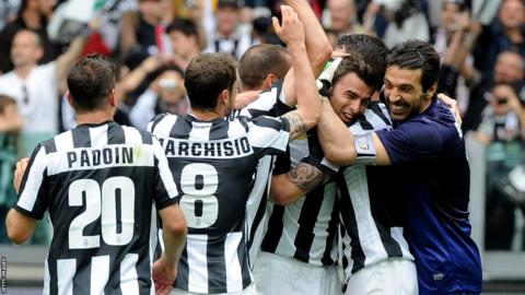 The Juventus players celebrate at the end of the 1-0 win at home to Palermo that secured a record 29th Serie A title with four games to play