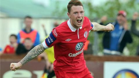 Lee Lynch celebrates the opening goal
