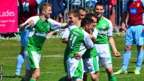 Guernsey FC players celebrate their goal against Farnham Town