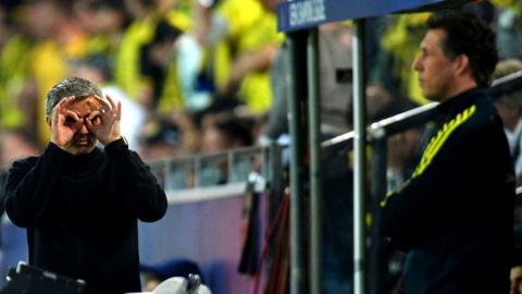 Jose Mourinho gestures at an official